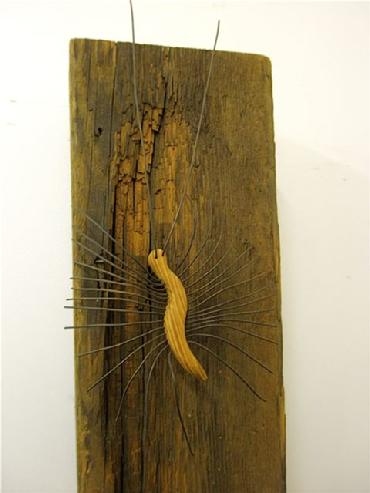 Hardware and natural elements mixed media wood and metal